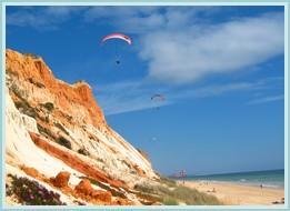 Paragliding over Falesia Beach